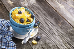 Healthy breakfast. Blue portioned ceramic bowls with corn flakes  fresh blueberries Stock Photo
