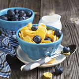 Healthy breakfast. Blue portioned ceramic bowls with corn flakes fresh blueberries Royalty Free Stock Photography