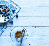 Healthy Breakfast with blueberries and banana yogurt. Biscuits, marmalade, coffee and peaches over a light wooden background Stock Photography