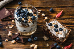 Healthy Breakfast with Blueberry. Healthy Breakfast. Yogurt with Blueberry and Granola. Toast with Curd and Berries stock photo