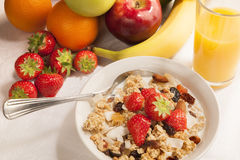 Healthy breakfast. Bowl of cereal and fruits on tabletop - breakfast stock photo