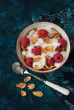 Healthy breakfast. A bowl of cereals with raspberries and yogurt on a table, healthy breakfast Stock Photos