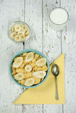 Healthy breakfast: bowl of Cornflakes with milk and banana Stock Photo