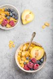 Healthy breakfast bowl. Cereals, fresh fruit, berries on table. Clean eating, diet concept. Top view. Healthy bowl with cereals, raspberries, blueberries, plum Royalty Free Stock Photo