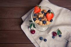 Healthy breakfast. Bowl of muesli with berries. Healthy breakfast. Bowl of muesli, strawberries and blueberries Stock Images