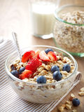 Healthy breakfast, bowl of muesli with milk Royalty Free Stock Photos