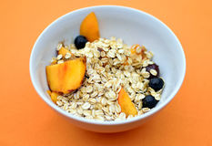 Healthy breakfast. Bowl of muesli with oatmeal and fresh fruit Stock Photography