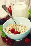 Healthy breakfast with bowl of oat flakes Stock Photo