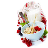 Healthy breakfast with bowl of oat flakes. Bowl of oat flake, berries and fresh milk on white background - health and diet concept Royalty Free Stock Image