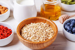Healthy breakfast - bowl of oat flakes with fresh fruit, almond. And honey, selective focus Royalty Free Stock Photos