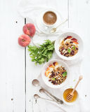 Healthy breakfast. Bowl of oat granola with yogurt Stock Photos