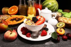 Healthy breakfast. Bowl of yogurt with granola and berries, fresh fruits and smootihies royalty free stock photography