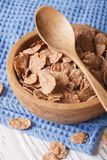 Healthy breakfast: Bran flakes in a wooden bowl Royalty Free Stock Images