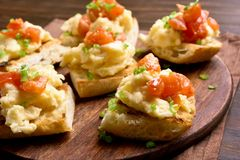 Healthy breakfast with bread toast, scrambled eggs, tomato Royalty Free Stock Photography