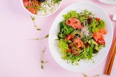 Healthy breakfast. Buddha bowl with rice, mango, avocado and salmon royalty free stock photography