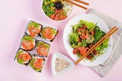 Healthy breakfast. Buddha bowl with rice, mango, avocado and salmon royalty free stock photo