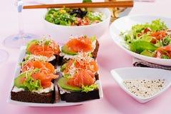 Healthy breakfast. Buddha bowl with rice, mango, avocado and salmon royalty free stock image