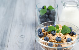 Healthy breakfast cereal with blueberries and milk Stock Image