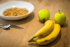 A healthy breakfast cereal bowl with fruit on a wooden table royalty free stock photo