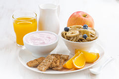 Healthy breakfast - cereal, fruit, yogurt and juice, close-up Royalty Free Stock Image