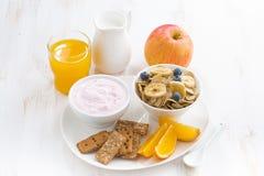 Healthy breakfast - cereal, fruit, yogurt and juice Stock Images