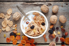 Healthy breakfast: cereal wheat flakes with milk in bowl. Royalty Free Stock Images