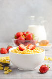 Healthy breakfast - cereal in a white bowl with strawberries, milk and honey Stock Photos