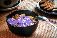 Healthy breakfast cereal with yogurt and dried fruit royalty free stock photo