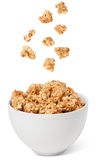 Healthy breakfast cereals. Falling in bowl Royalty Free Stock Photos