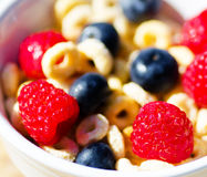 Healthy breakfast with cereals and berries. Healthy breakfast with cereals, blueberry, raspberry. Selective focus Stock Photography