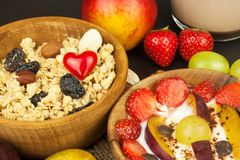 Healthy breakfast with cereals and colorful fruits. Yogurt with fruit and oatmeal. Meals for successful athletes. Food for kids Royalty Free Stock Photos