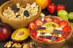 Healthy breakfast with cereals and colorful fruits. Yogurt with fruit and oatmeal. Meals for successful athletes. Food for kids Stock Images