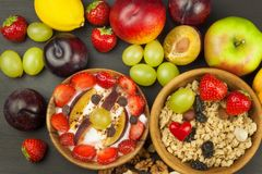 Healthy breakfast with cereals and colorful fruits. Yogurt with fruit and oatmeal. Meals for successful athletes. Food for kids Stock Photo