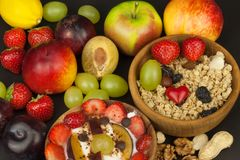 Healthy breakfast with cereals and colorful fruits. Yogurt with fruit and oatmeal. Meals for successful athletes. Food for kids Stock Image