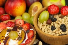 Healthy breakfast with cereals and colorful fruits. Yogurt with fruit and oatmeal. Meals for successful athletes. Food for kids Royalty Free Stock Image