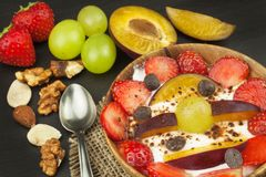 Healthy breakfast with cereals and colorful fruits. Yogurt with fruit and oatmeal. Meals for successful athletes. Food for kids Royalty Free Stock Photography