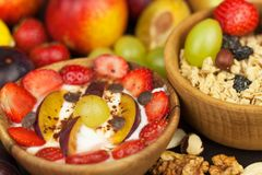 Healthy breakfast with cereals and colorful fruits. Yogurt with fruit and oatmeal. Meals for successful athletes Royalty Free Stock Images