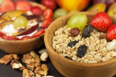 Healthy breakfast with cereals and colorful fruits. Yogurt with fruit and oatmeal. Meals for successful athletes Royalty Free Stock Photography
