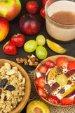 Healthy breakfast with cereals and colorful fruits. Yogurt with fruit and oatmeal. Meals for successful athletes Royalty Free Stock Image