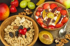 Healthy breakfast with cereals and colorful fruits. Yogurt with fruit and oatmeal. Meals for successful athletes Royalty Free Stock Photo