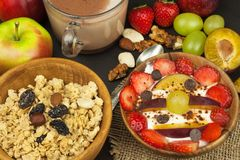 Healthy breakfast with cereals and colorful fruits. Yogurt with fruit and oatmeal. Meals for successful athletes Stock Image