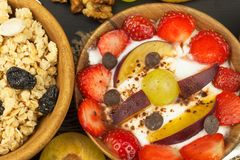 Healthy breakfast with cereals and colorful fruits. Yogurt with fruit and oatmeal. Meals for successful athletes Stock Images