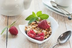 Healthy Breakfast cereals: granola, muesli with fruit and berries strawberries and raspberries with dairy products. Selective focu. S. Close up Stock Photo