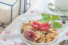 Healthy Breakfast cereals: granola, muesli with fruit and berries strawberries and raspberries with dairy products. Selective focu. S. Close up Stock Photography