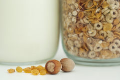 Healthy breakfast with cereals, milk, nuts and raisins. On white background Royalty Free Stock Photo