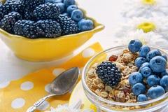 Healthy Breakfast cereals: muesli with fruit, nuts and berries blueberries, blackberries. Selective focus. The horizontal frame Stock Photos