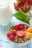 Healthy Breakfast cereals muesli with fruits and berries strawberries, raspberries and red currants with dairy products. Selective. Focus. The vertical frame Royalty Free Stock Photography