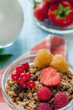 Healthy Breakfast cereals muesli with fruits and berries strawberries, raspberries and red currants with dairy products. Selective focus. The vertical frame Royalty Free Stock Photos