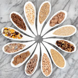 Healthy Breakfast Cereals. In porcelain dishes over marble background Royalty Free Stock Images