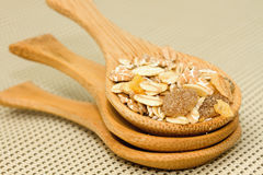 Healthy breakfast-cereals. Three wooden spoons filled with muesli Royalty Free Stock Images